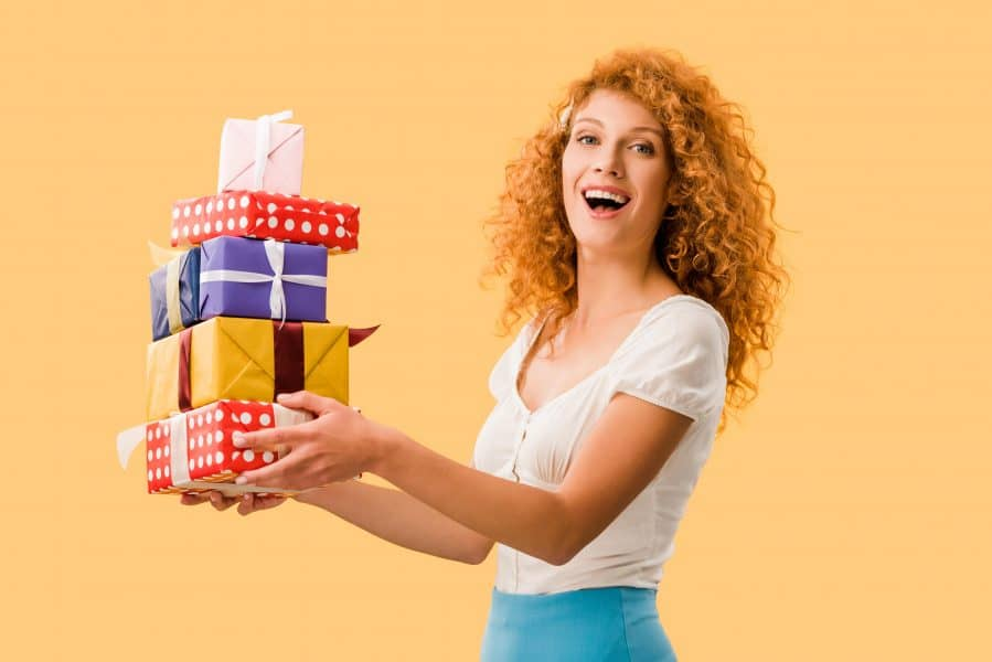 A girlfriend holding gifts for her boyfriend's family.