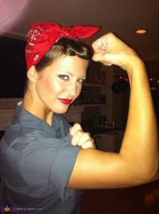 A women dressed as Rosie the Riveter.