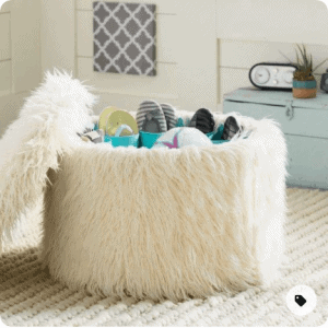 white fur ottoman as storage and sitting chair