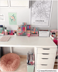 a desk with colorful markers