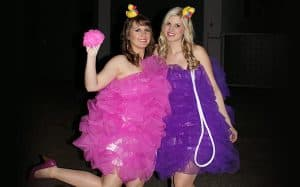 Two women dressed up as loofas.
