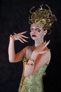 A women dressed up as medusa.