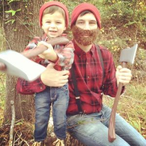 A man and his son dressed as lumberjacks.
