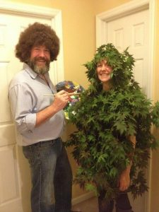 A man dressed as Bob Ross.