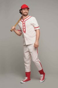 A man dressed as a baseball player.