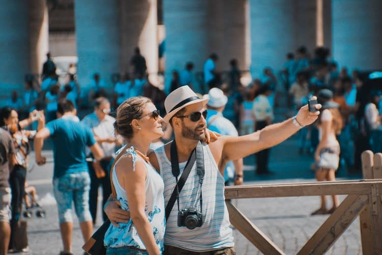 A couple of tourists taking a selfie together