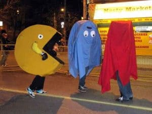 Three friends dressed up as Pacman and ghosts.