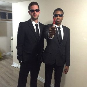 Two friends dressed up as Men in Black.
