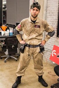 A man dressed as a ghostbuster.
