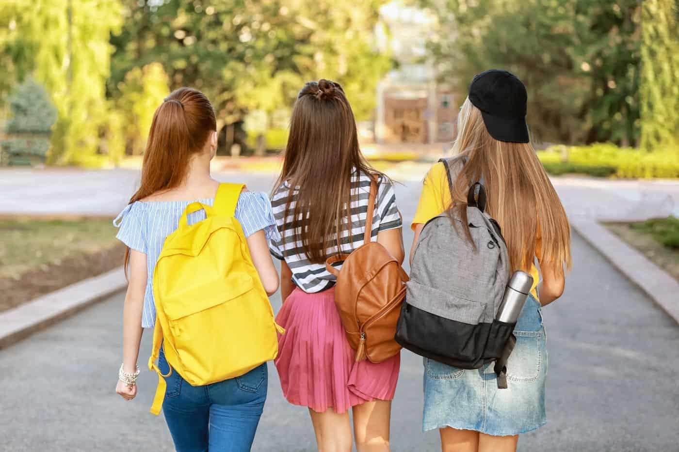 College girls wearing cute bags