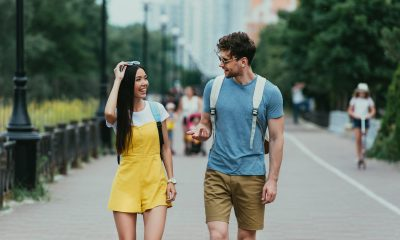 Handsome man and asian woman with glasses looking at each other