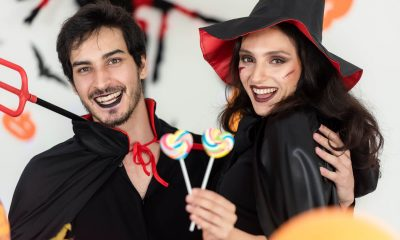 A couple wearing Halloween costumes
