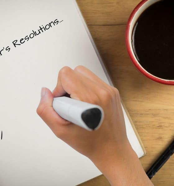 A person making a list of ideas for New Year's resolutions