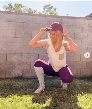 A girl in a baseball player costume