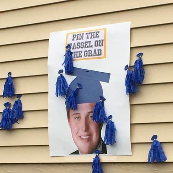 A picture of a grad pinned on a wall