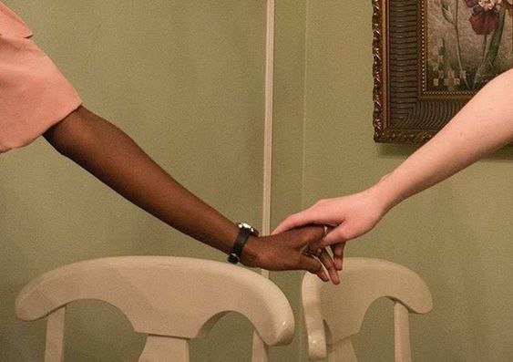 A picture of two hands holding each other