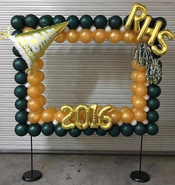 Balloons shaped like a square in green, yellow and white colors