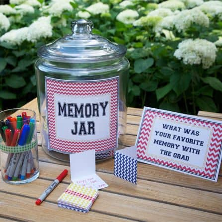 A memory jar on a table beside a can of markers and a card tht says