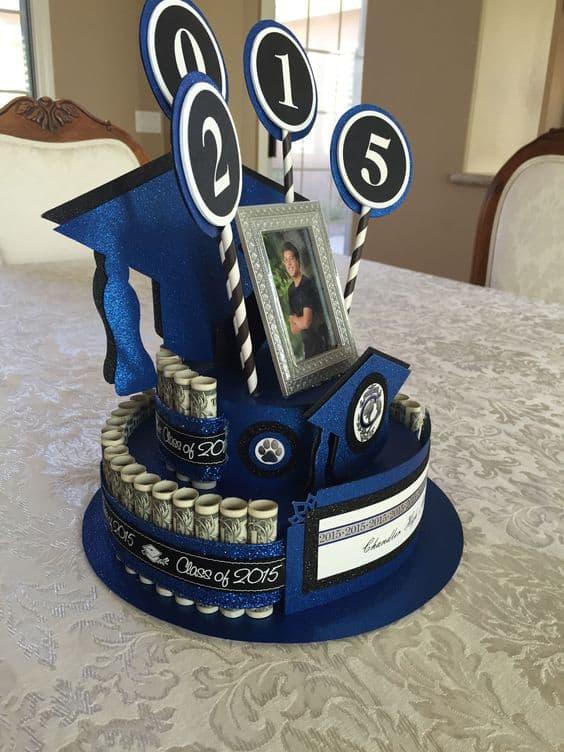 A blue theme money graduation cake