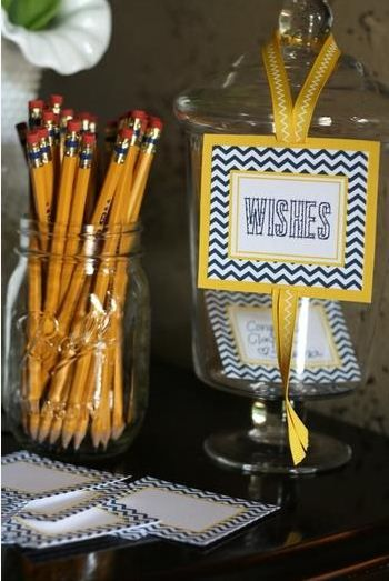 A wishes jar next to a jar full of pencils