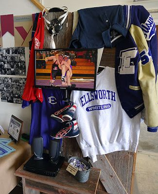 Jackets, shoes and pictures of sports in a room