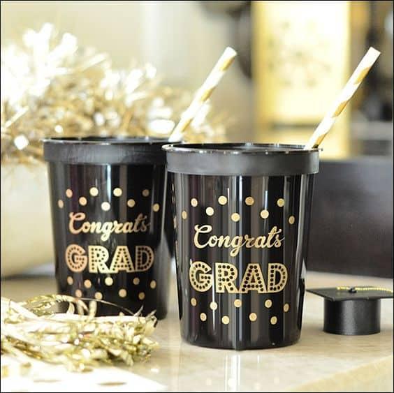 Two graduation cups labeled 'Congrats Grad'