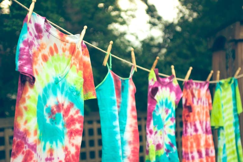 Tie die t-shirts hanging on a string