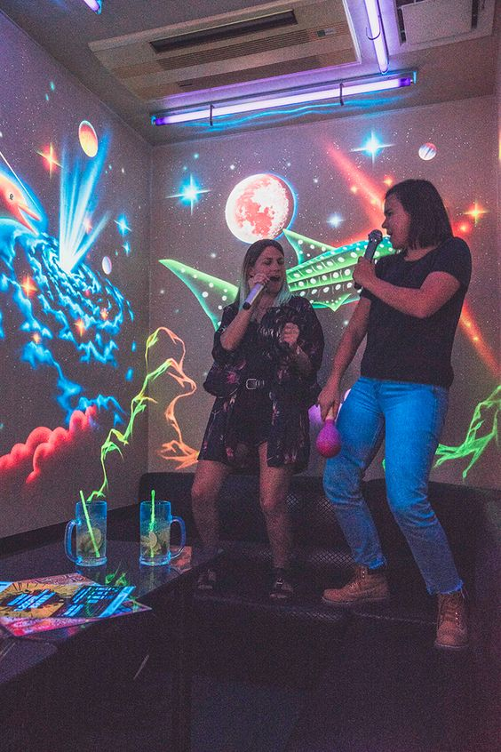 A couple singing at a karaoke