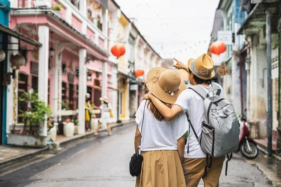 A couple walking in a town