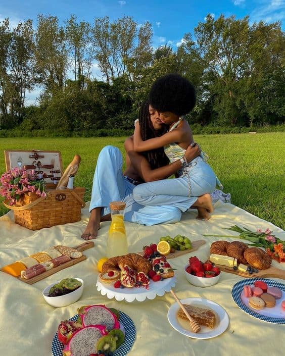 A couple during a picnic in a park