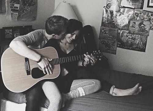 A couple playing guitar