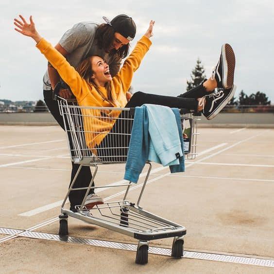 a couple having fun with a cart