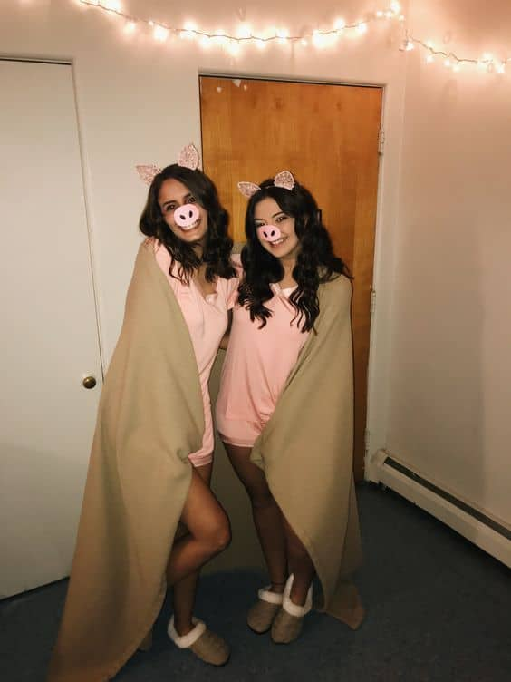 Two girls in a pig costume