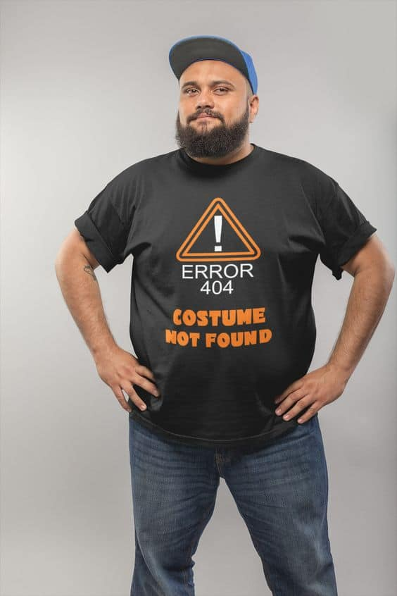 A man wearing a shirt labeled 'Error 404 Costume Not Found'