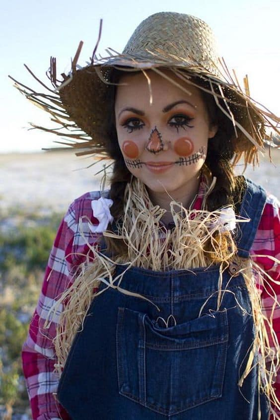 A woman in a scarecrow costume