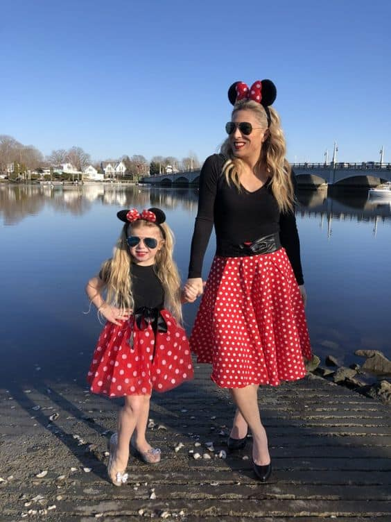 A mom and her daughter in Minnie mouse costumes