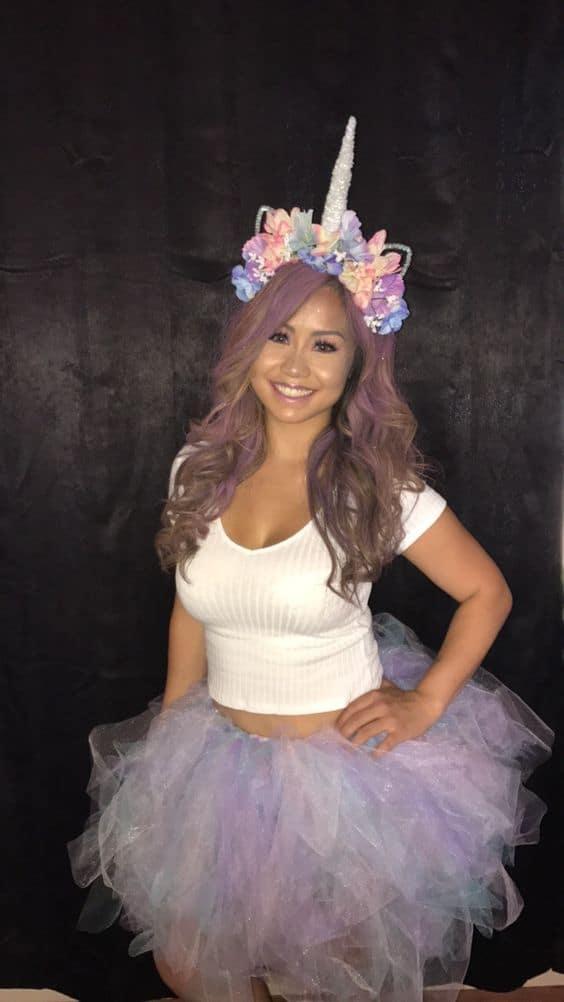 A girl in a unicorn costume