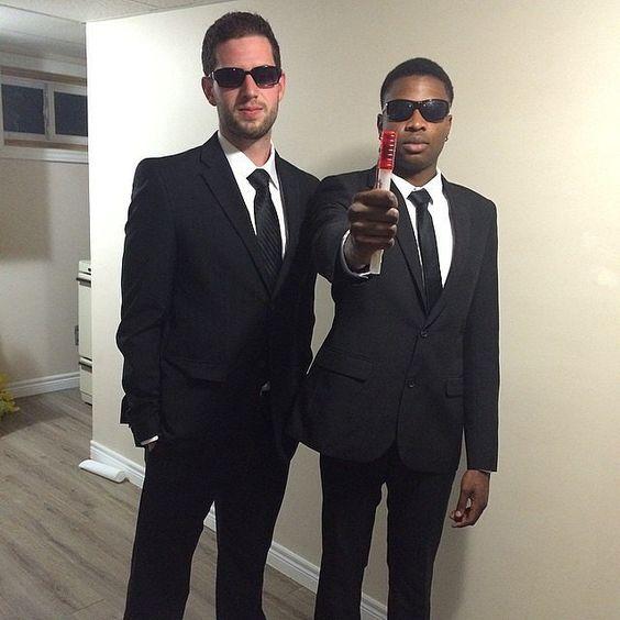 Two men in a black tux wearing sunglasses