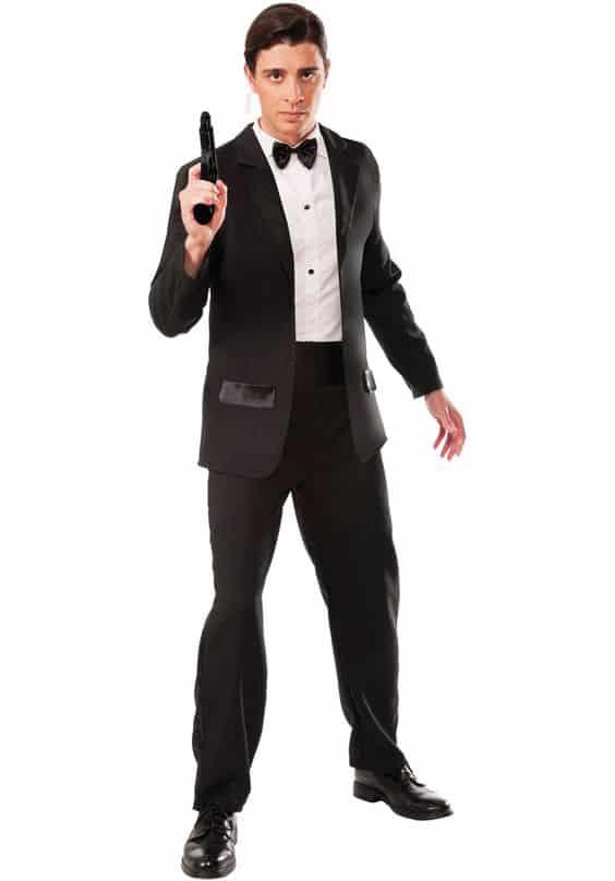 A guy in a tux posing as James Bond holding a gun