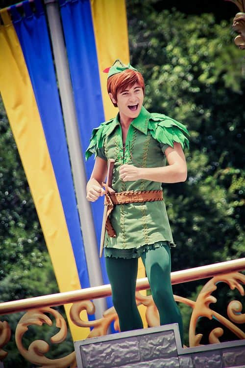 A smiling guy in Peter Pan's costume