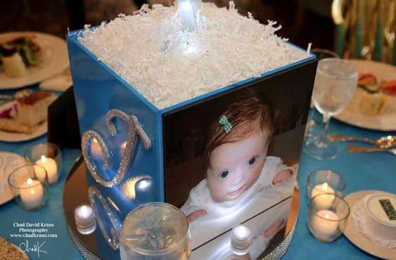 photo box centerpiece on a table