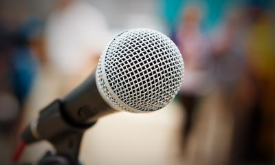 a microphone in a class for persuasive speech topics for college students