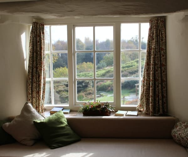 A window with open curtains