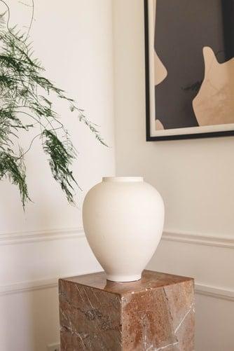 A beige ceramic vase