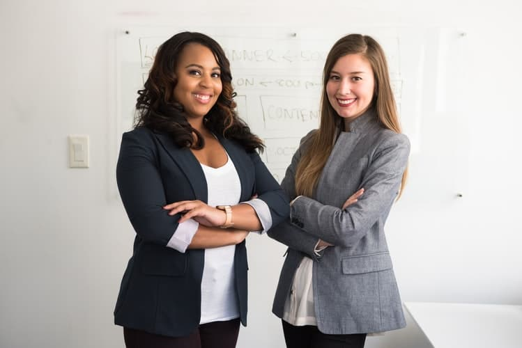 Two women in suits