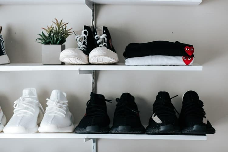 Pairs of sneakers on a show organizer