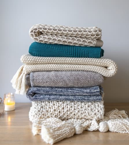 Knit clothings in a pile