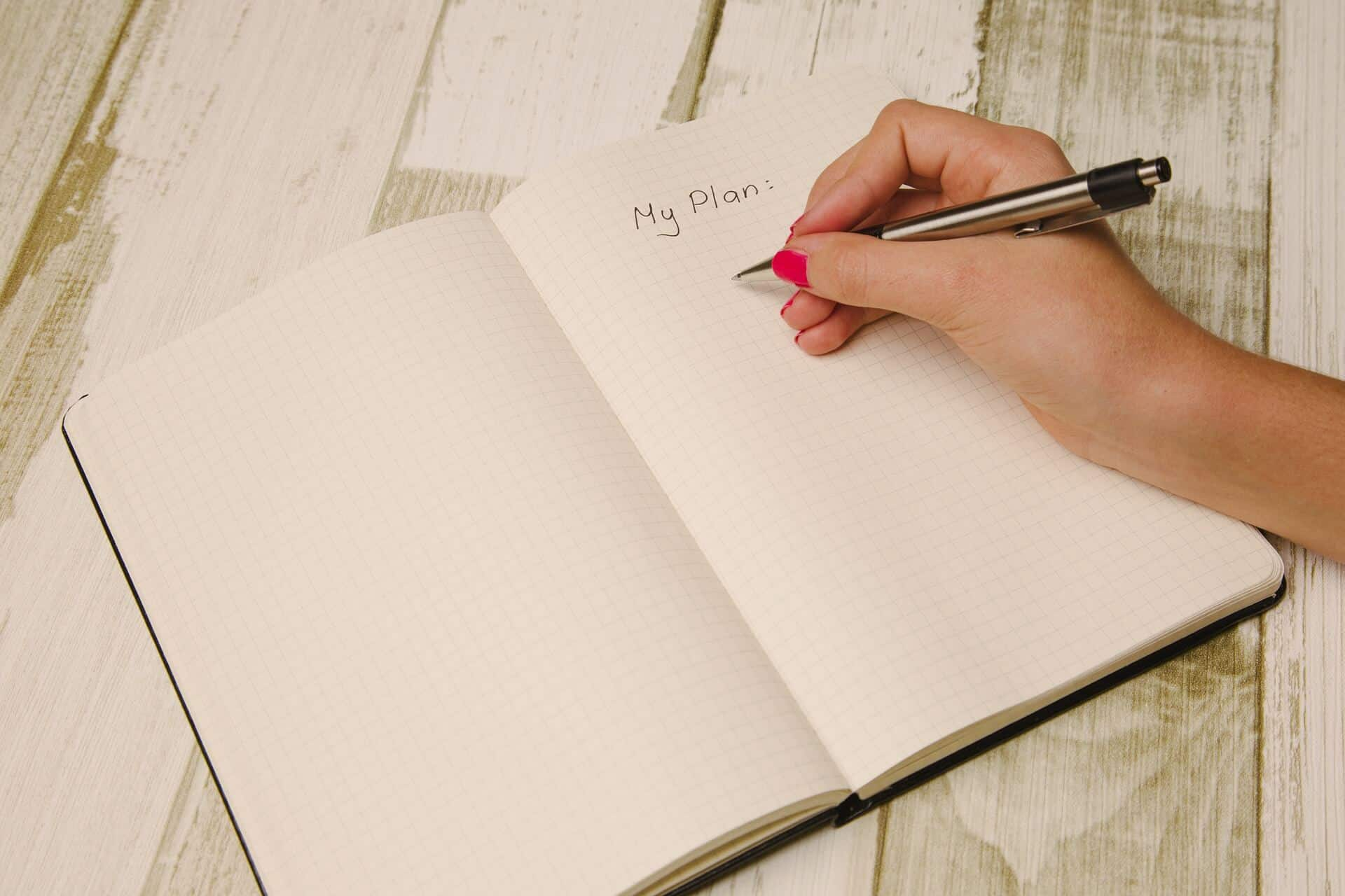 Person writing on a notebook MY PLAN