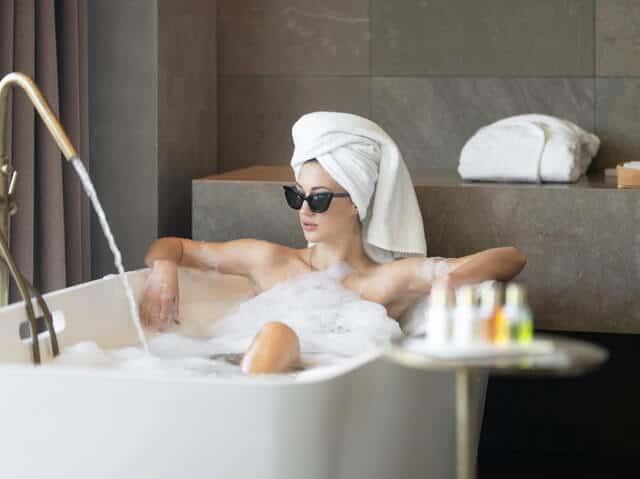 a woman in a bathtub having a psa day