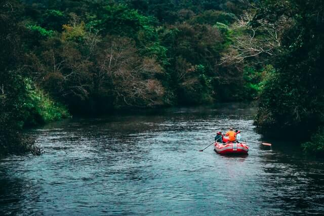 White water rafting down a river in the woods